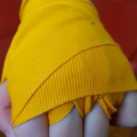 yellow boxing hand wraps.