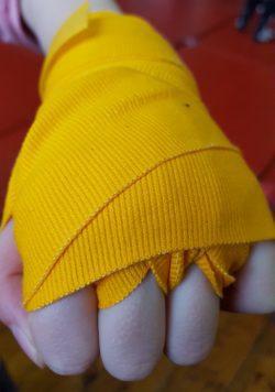 yellow boxing hand wraps.